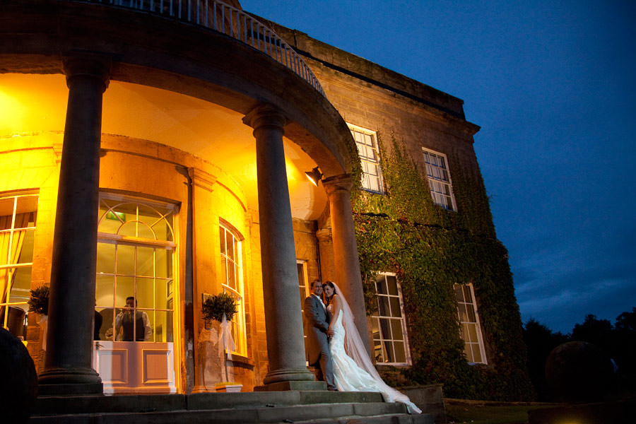 Wedding shoot of Bride and Groom on the Steps of Wood Hall Hotel