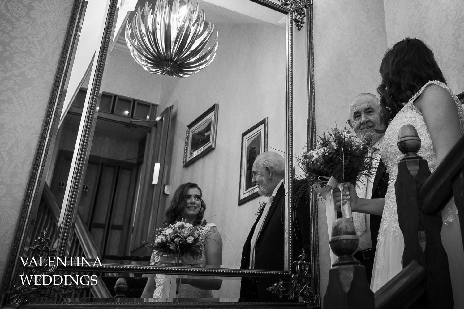 Bride coming down stairs in Lodore Falls Hotel