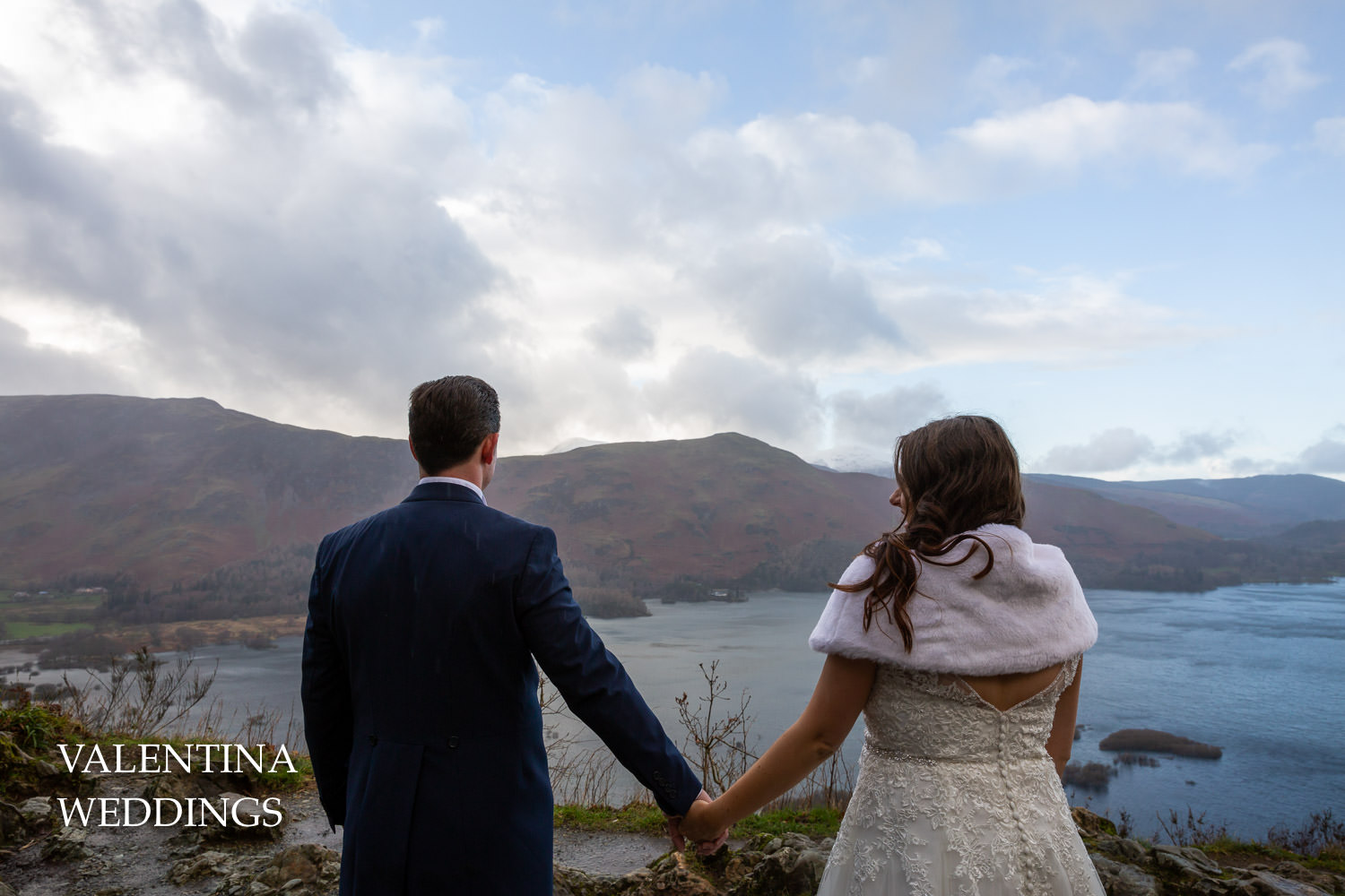 Bride and groom looking out to Cat Bells mountain