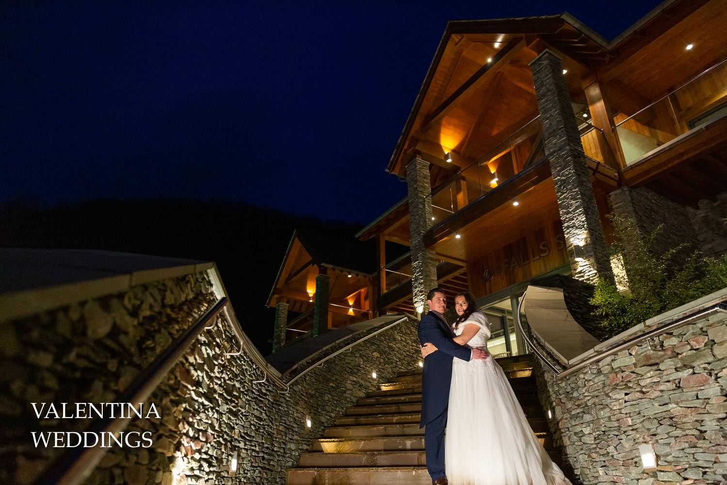 Bride and groom in front of Lodore Falls spa