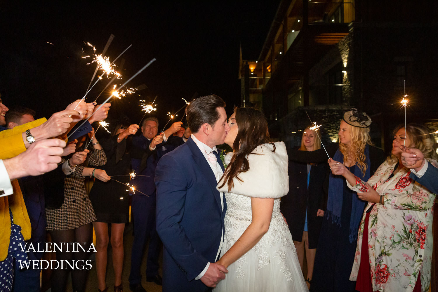 Sparkler kiss with bride and groom