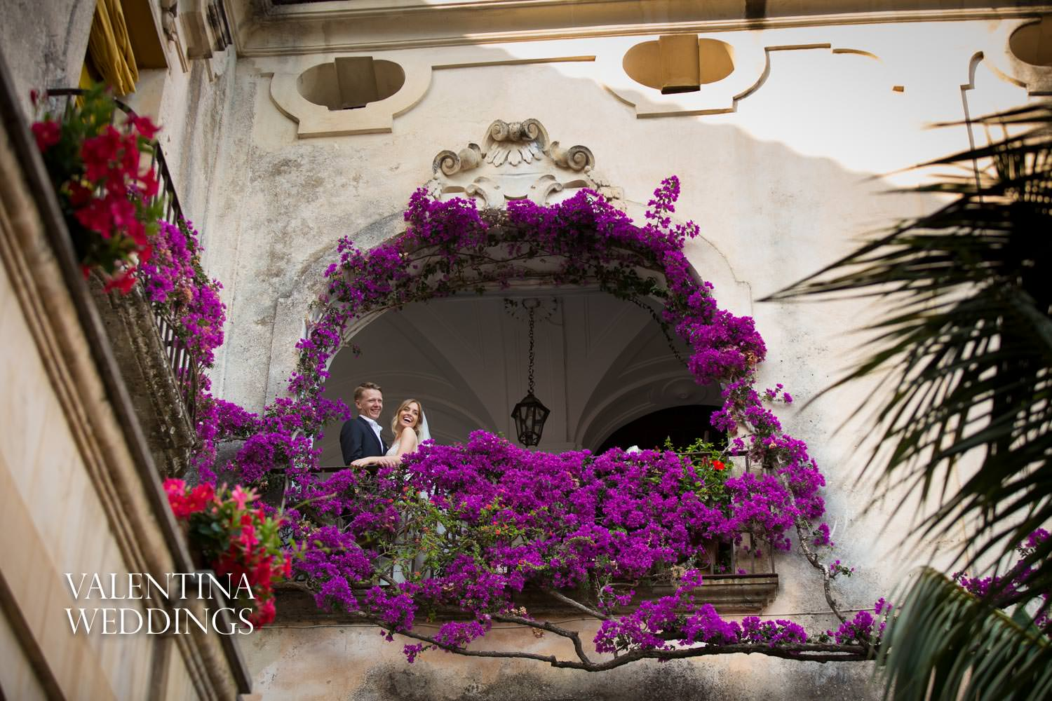 Bride and groom on balcony at Palazzo Murat Positano