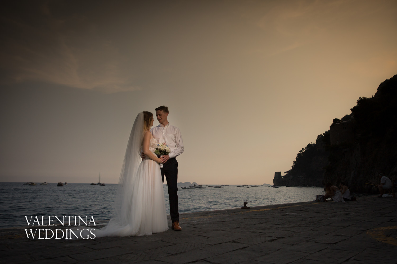Bride and groom at sunset in Positano